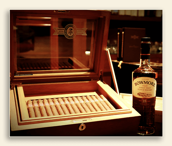 Image showing a box of cigars with a bottle of whisky beside it.